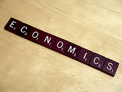Scrabble tiles spelling economics.
