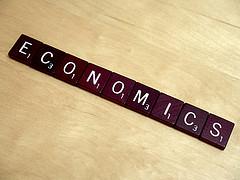 Scrabble tiles spelling economics.