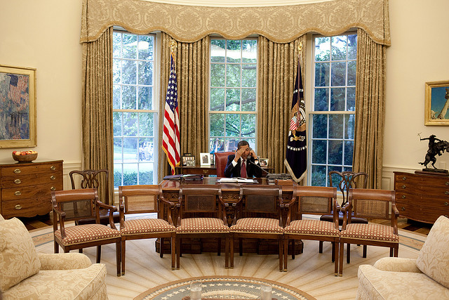 President Obama on the phone in the Oval Office
