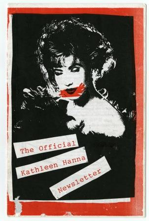 Cover of the Official Kathleen Hanna Newsletter. Black and white image of woman's face with red detail on lips. Title in red typescript on white background.