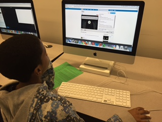 Students working on computer coding projects