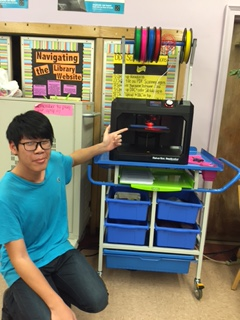 Student with 3D printer in use