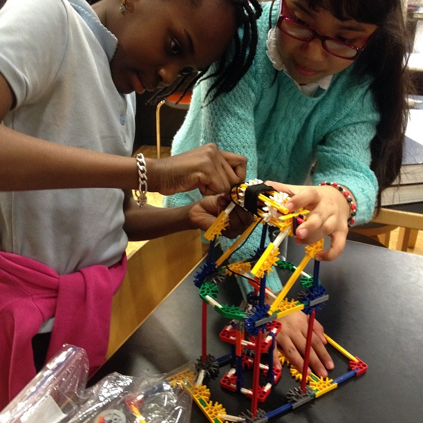Students building a structure with K'Nex