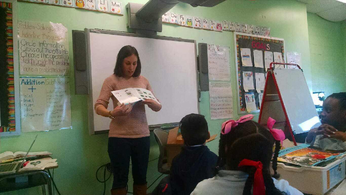 Librarian instructing a class of students