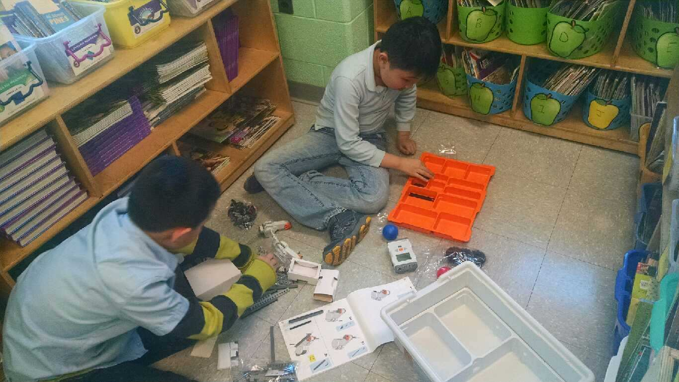 Students in a Lego robotics club