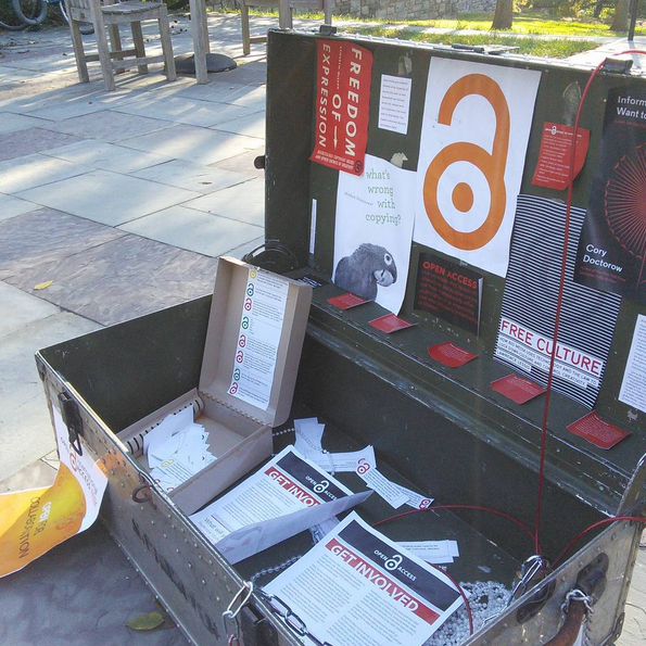 A photo of the 2015 open access week trunk, unlocked. Inside is literature about open access and how to get involved, as well as the box of clues that led to the opening of the locks.