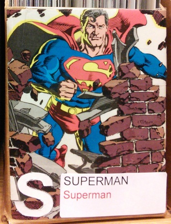 A picture of the front of a box for Superman