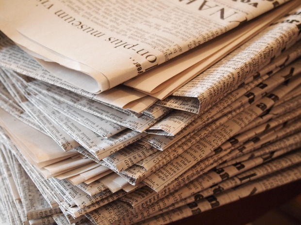 A photo of a pile of newspapers
