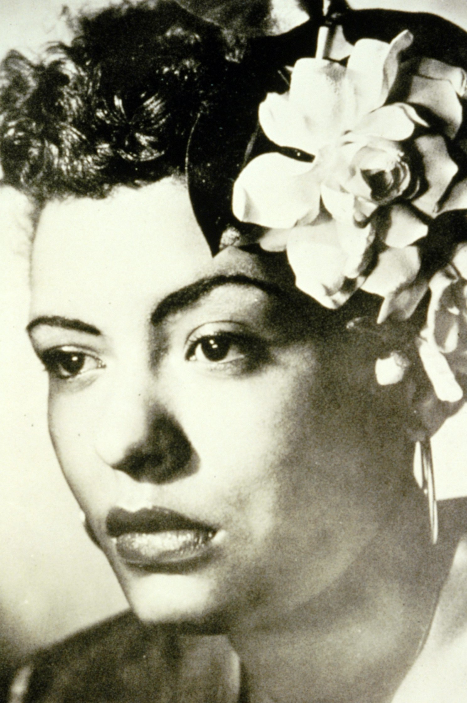 Image of Billie Holliday with flowers in her hair