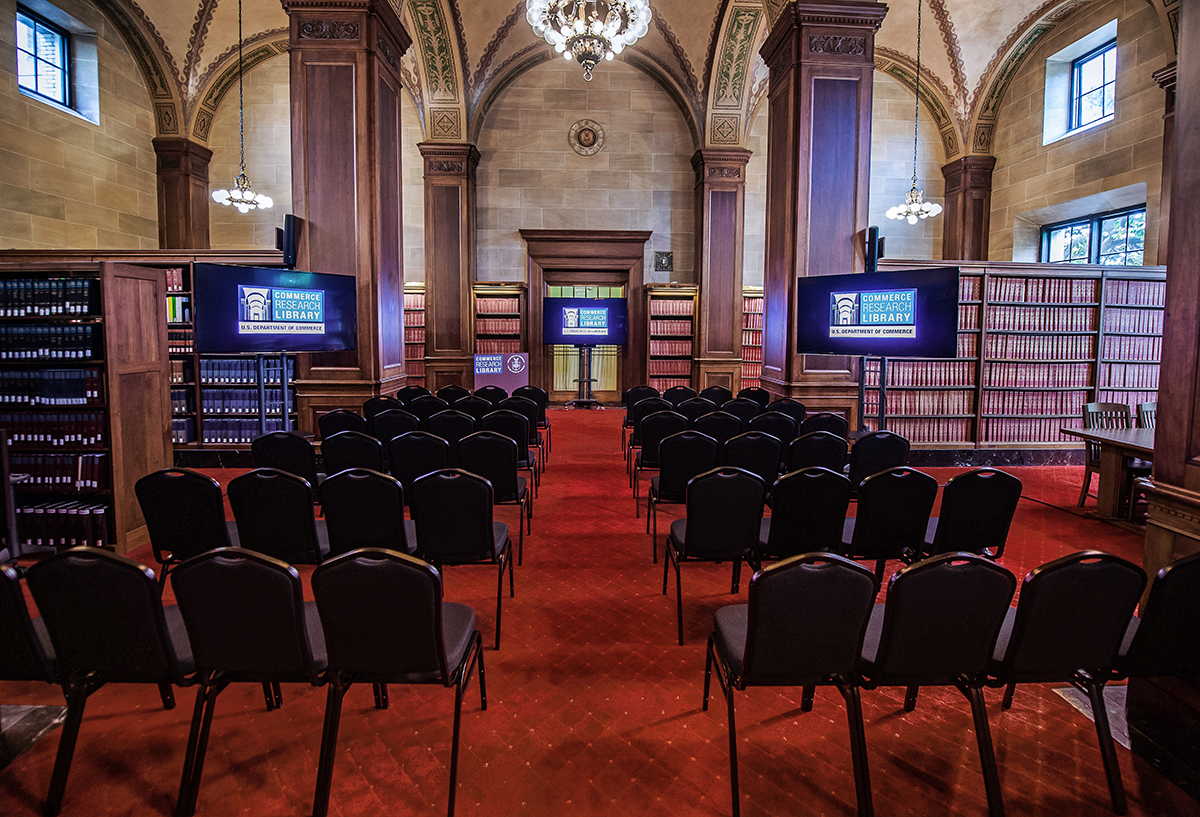 A photo of the Library's Reading Room depicting seating for 100 attendees.