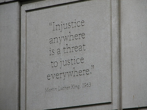 "Wall engraving that reads ""Injustice anywhere is a threat to justice everywhere"""