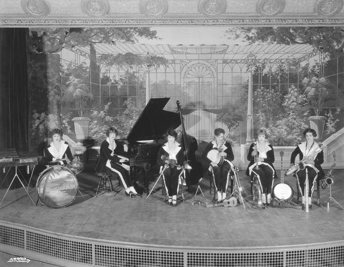 A group of female musicians seated on a stage