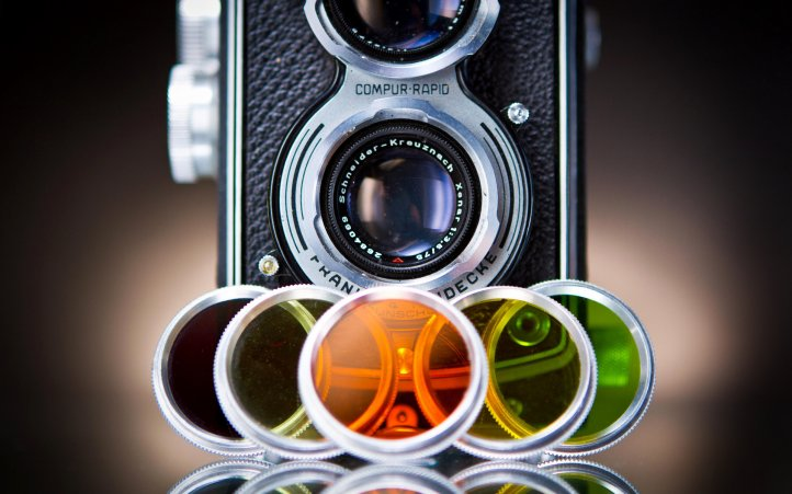 image of camera with lense/colored filters