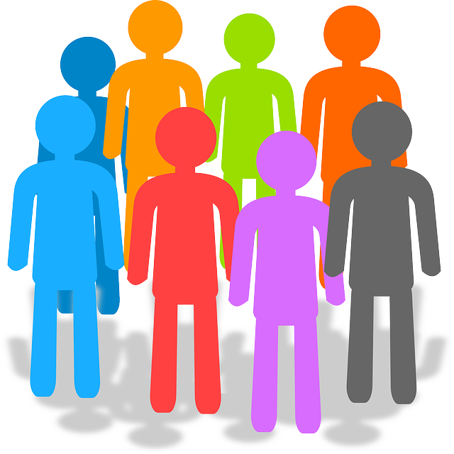 Different coloured silhouettes of people, standing in a circle.