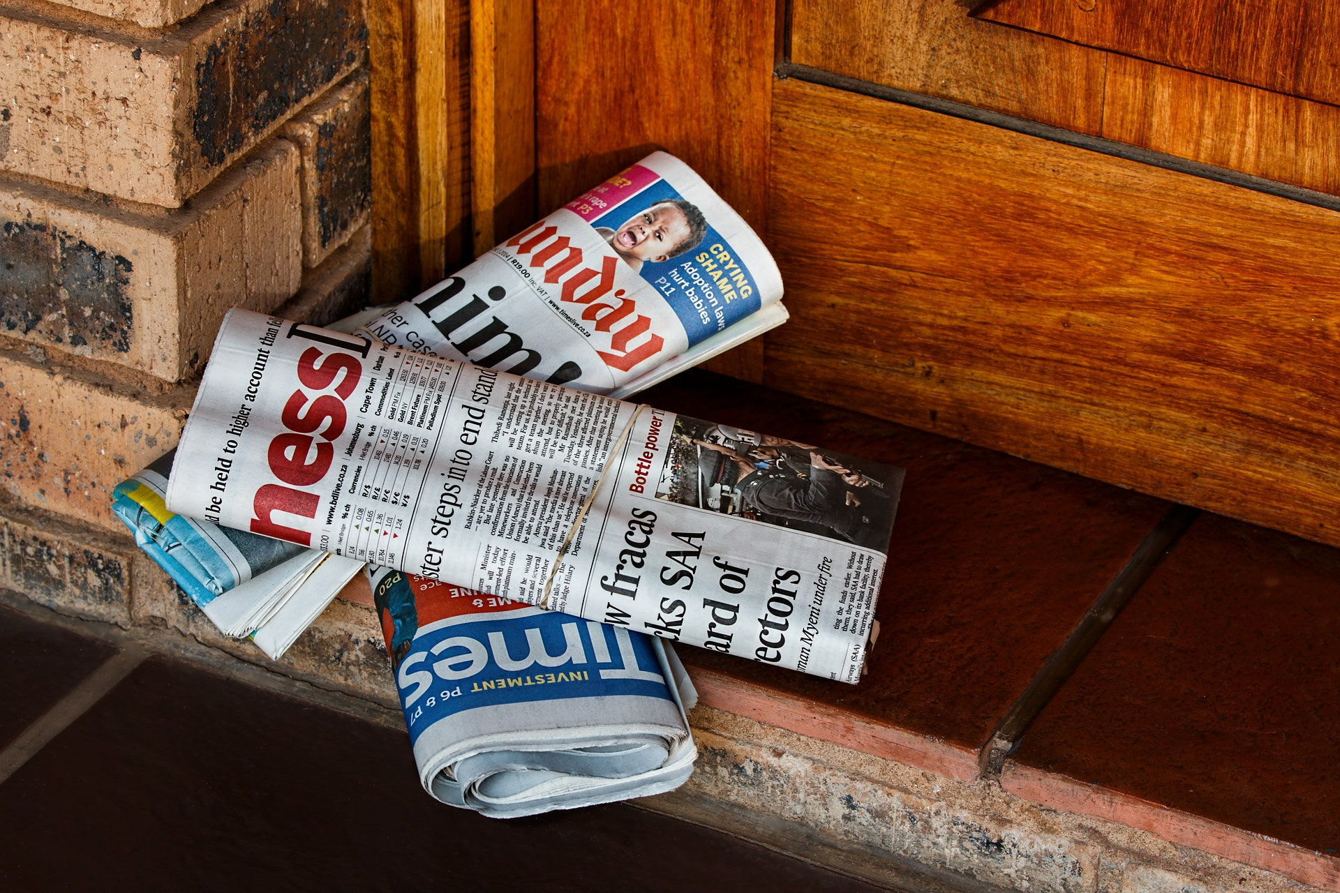 Image of newspapers on doorstep