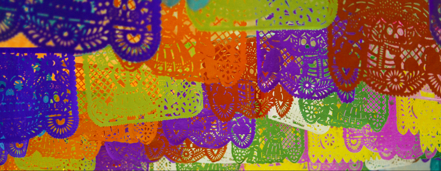 Photo of banners of papel picado--cut paper designs