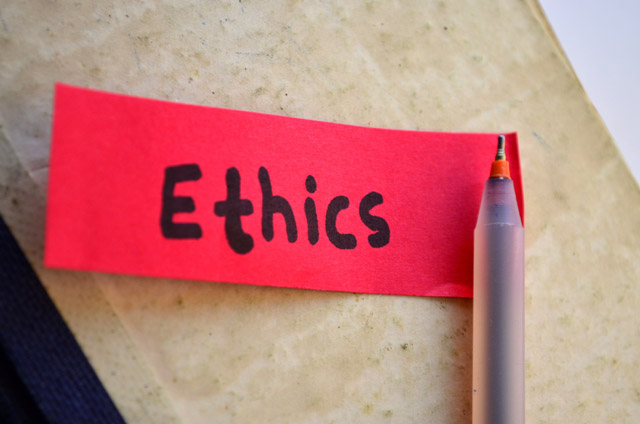 "Image of the word ""ethics"" written on a small piece of paper."