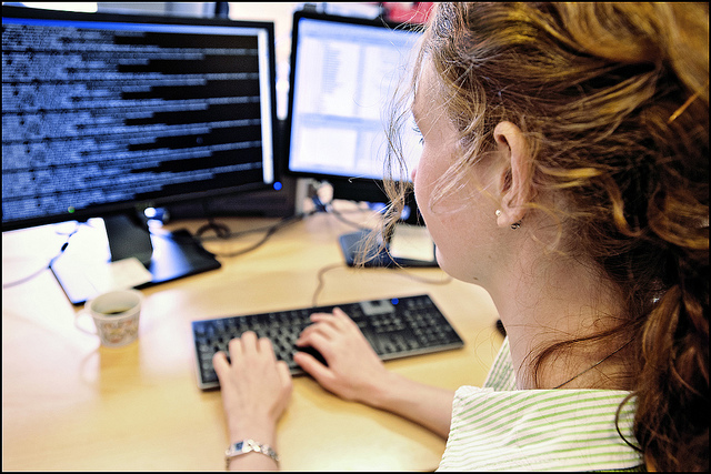 Woman researching at a computer