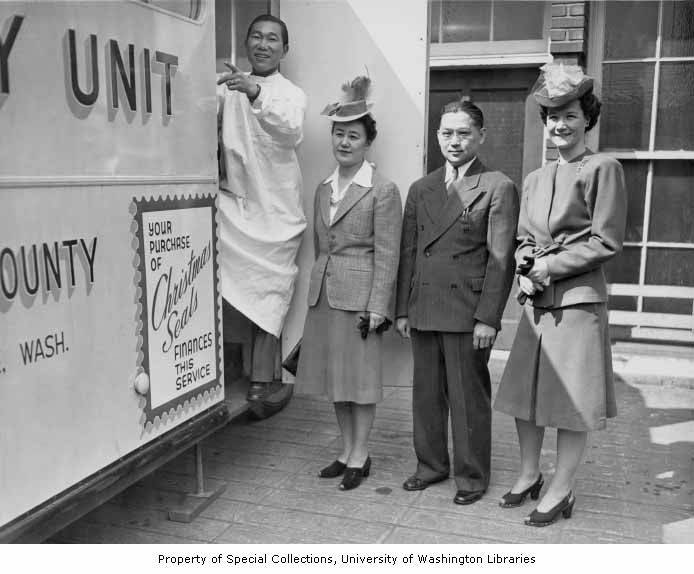 photo of men and women outside a mobile x-ray unit of the king county tuberculosis league