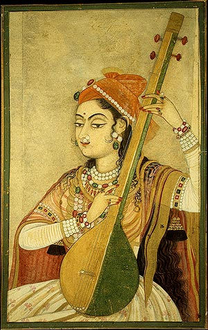 A woman playing a string instrument called Tanpura.