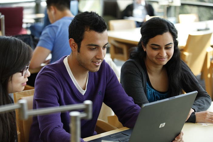 students using laptop in the library