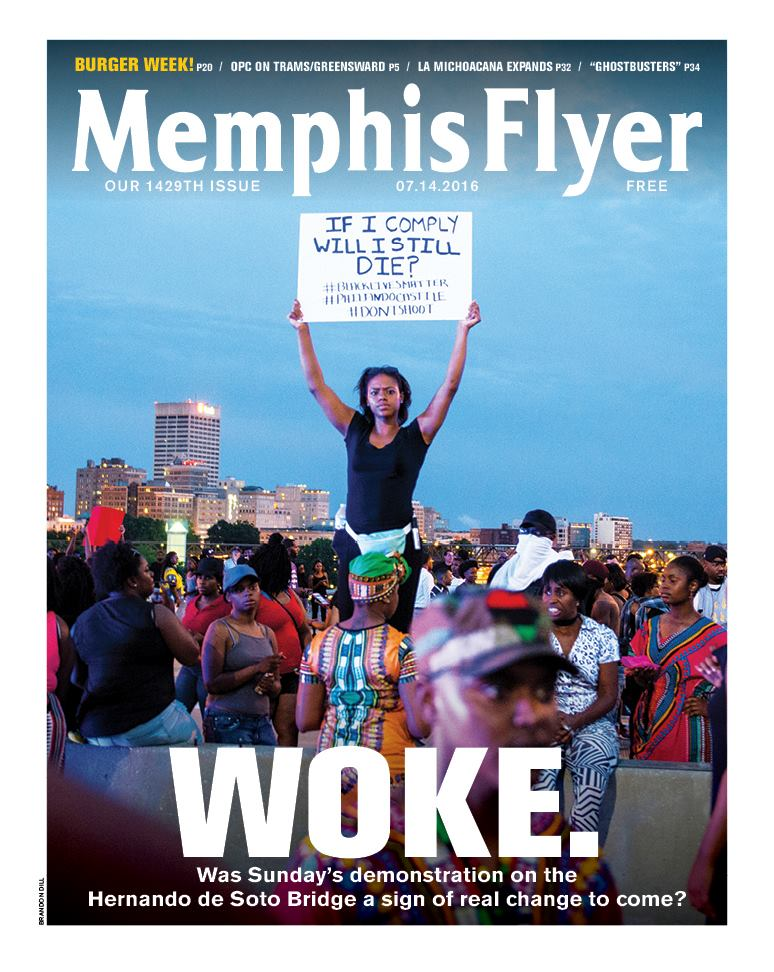 "The cover of the July 14, 2016 issue of the Memphis Flyer shows a young African American woman held above a crowd of African American protesters holding a sign that reads, ""If I comply, will I still die?"" The headline for the cover is ""Woke."""