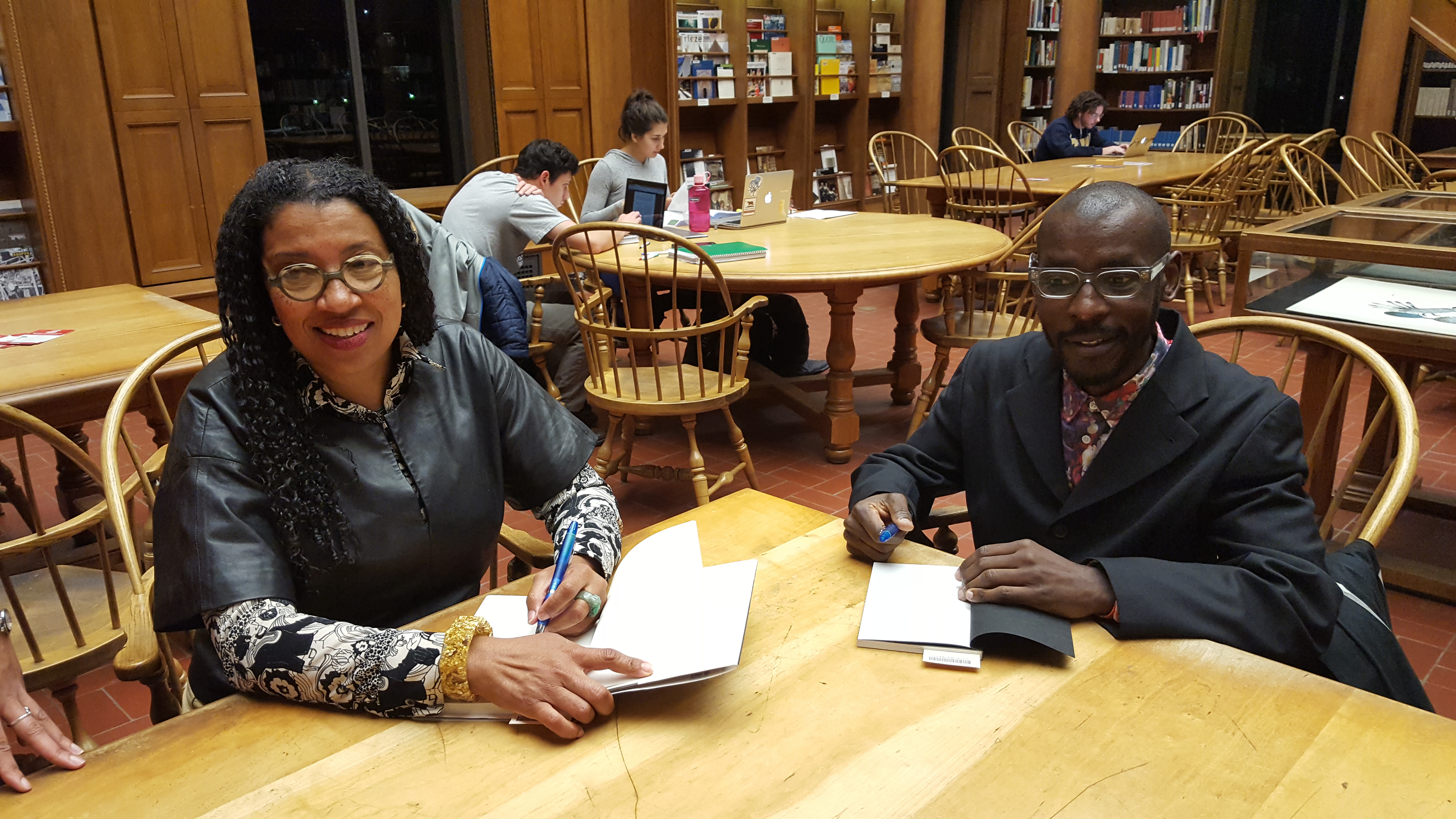 Robin Coste Lewis and Mario Gooden signing books
