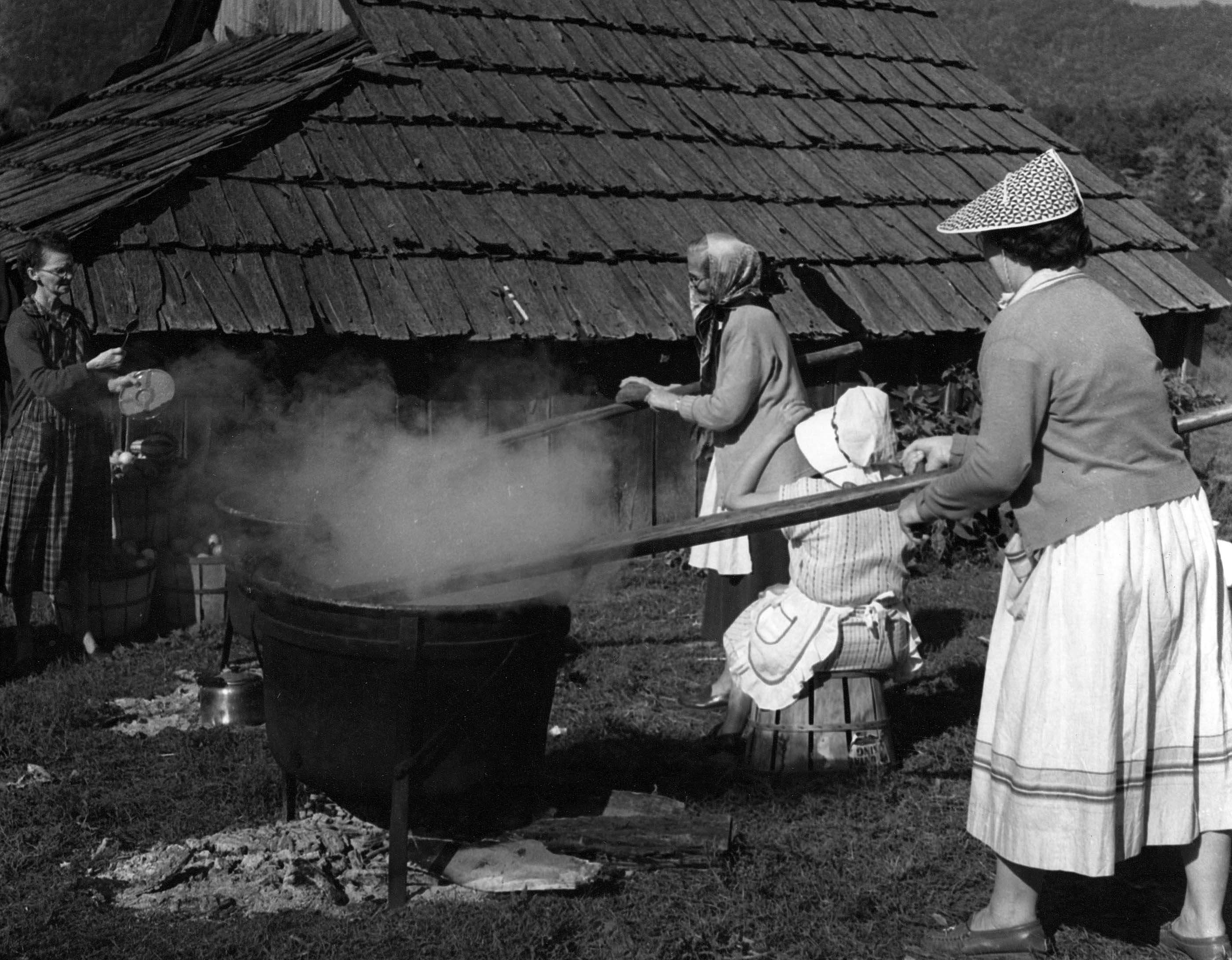 Women cooking apple butter