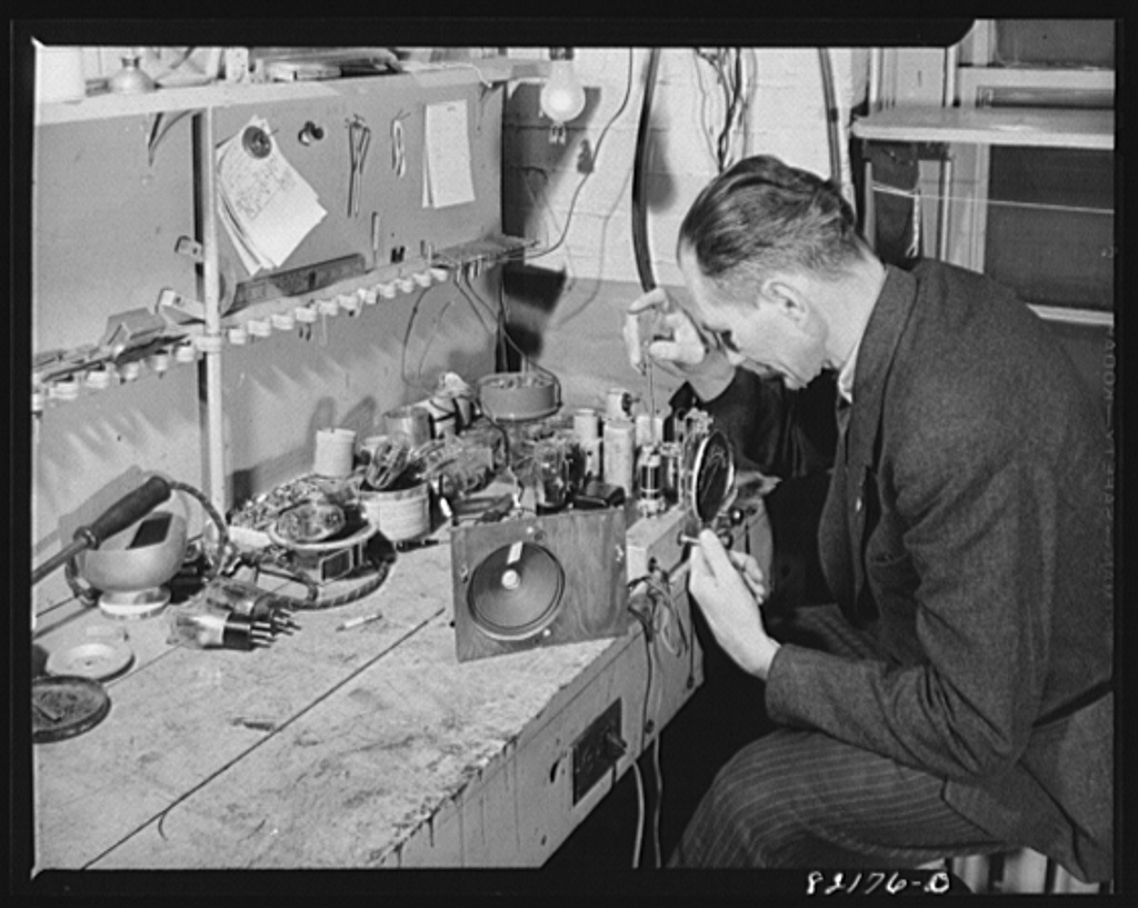 Image vintage photo of man working on electronics project