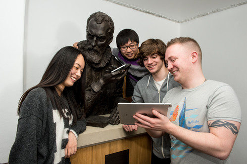 Visiting IT students form China with the John Napier statue.