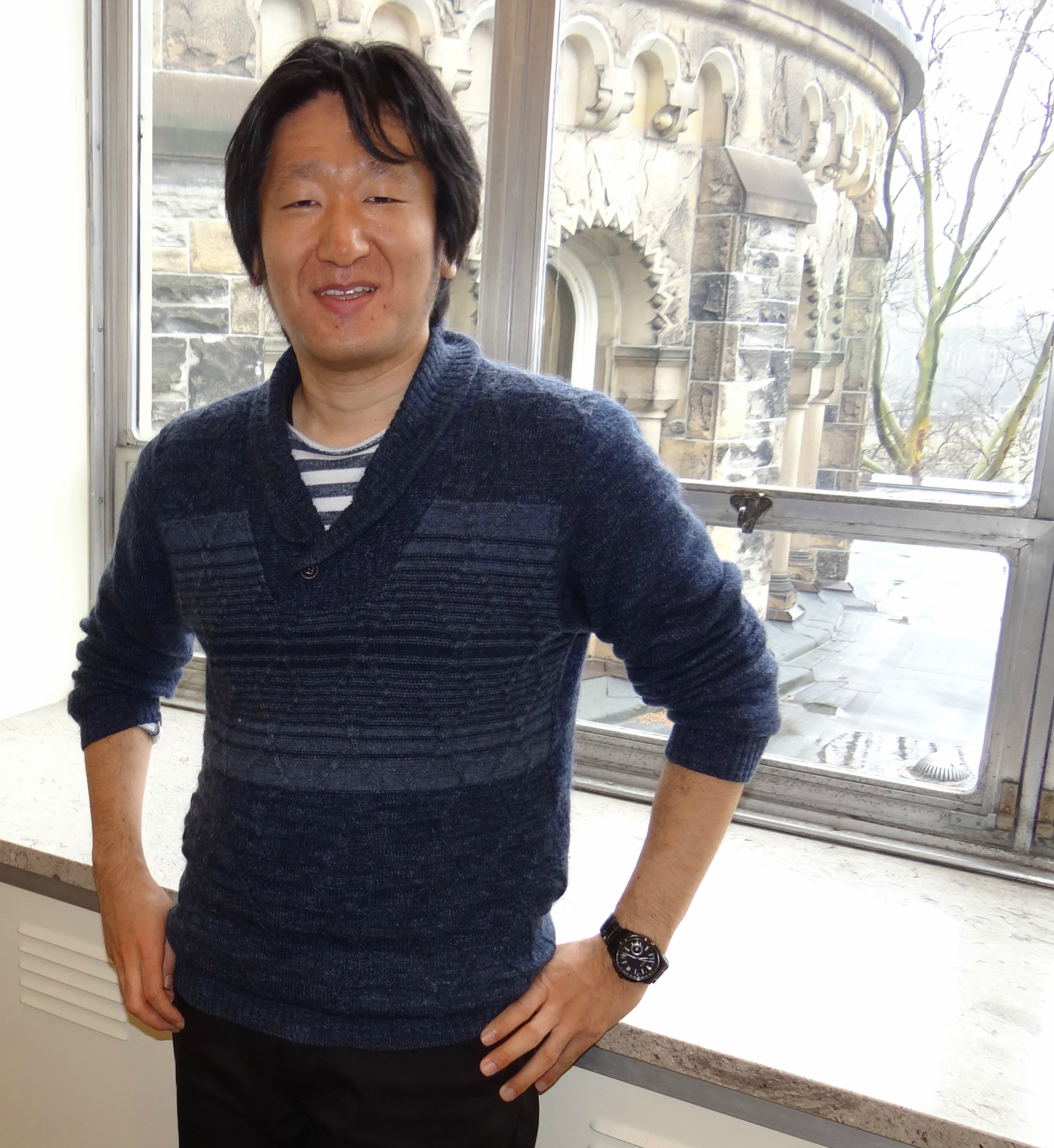 Visiting Librarian Kosuke Tanabe in front of windows looking out of Gerstein