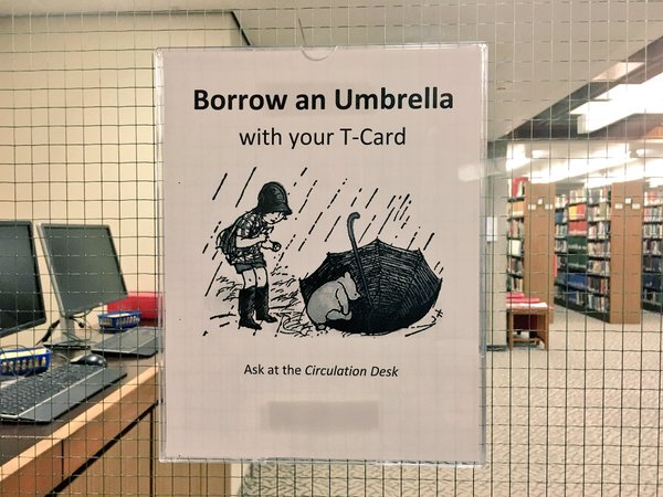 "Picture of sign ""Borrow an Umbrella with your T-Card"""