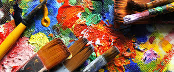 colorful paint, canvas, and brushes