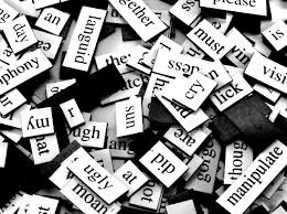 pile of Magentic Poetry word magnets