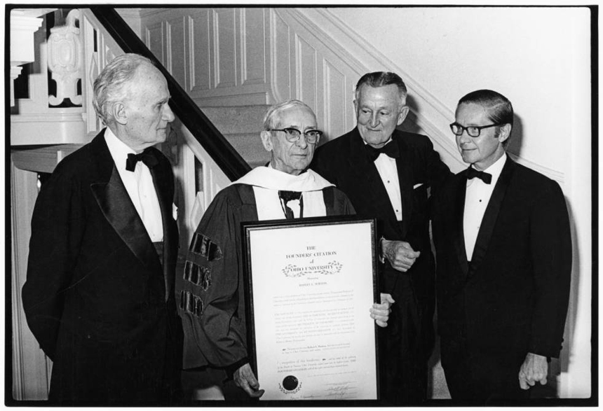 A black and whit picture of Robert Morton receiving Founders Citation, 1972. The picture shows, from left to right, John C. Baker, Robert Morton with Founders Citation, John Galbreath, and Vernon Alden.