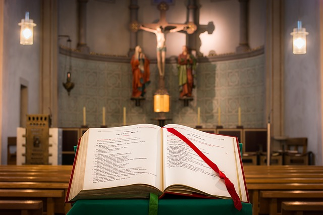 Missal inside church with altar and crucifix