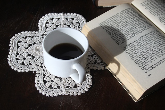 Doily, cup of tea and book