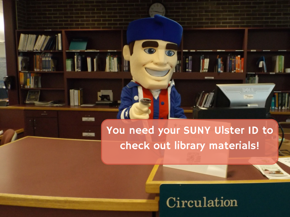 Senator Sam at the Circulation Desk. You need your student ID to check out library materials