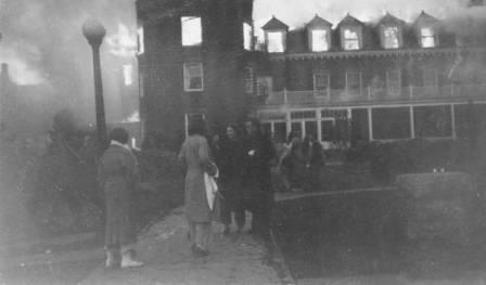 Picture of people standing outside a burning North Hall