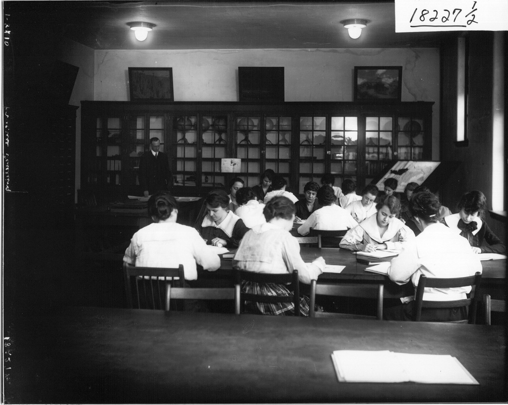 picture of women in a classroom writing