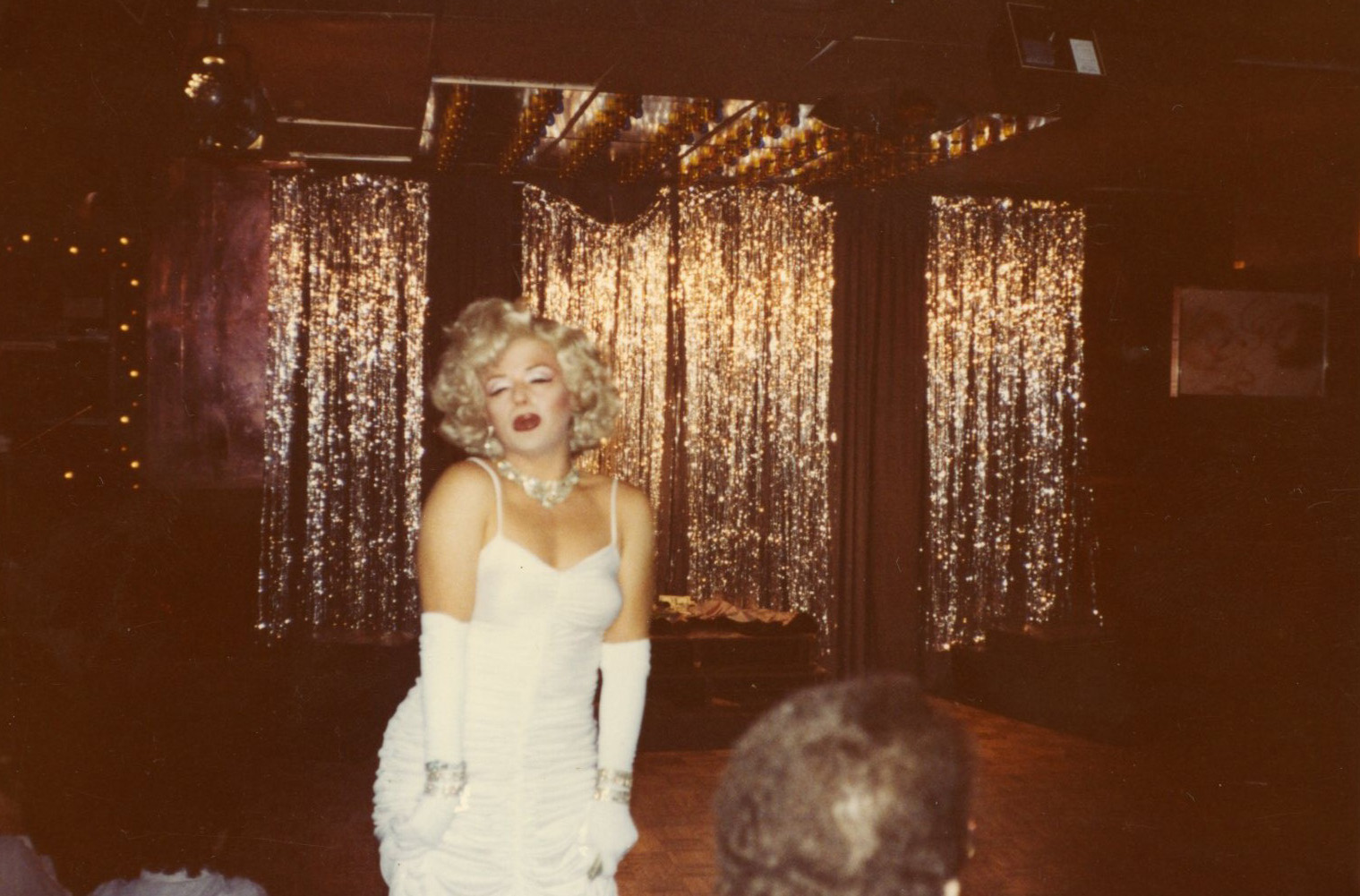 Marilyn Monroe drag impersonator performing; photo from MS 117 Lollie Johnson Papers