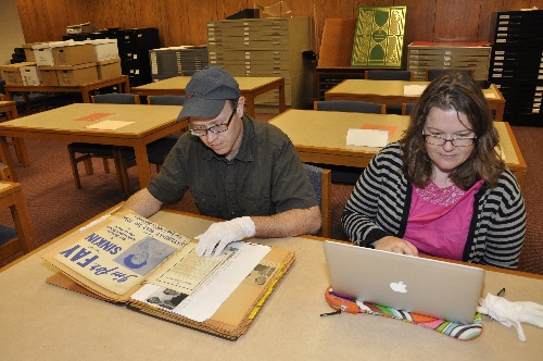 Two researchers using Special Collections resources at the Institute of Texan Cultures
