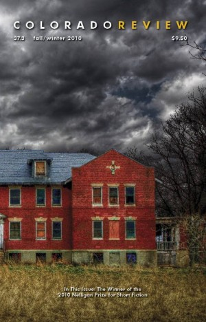 Colorado Review showing cover with photo of red brick building below great cloudy sky
