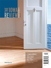 The Iowa Review cover showing an open white door with a hardwood floor room with a glimpse of blue water and sky outside the door