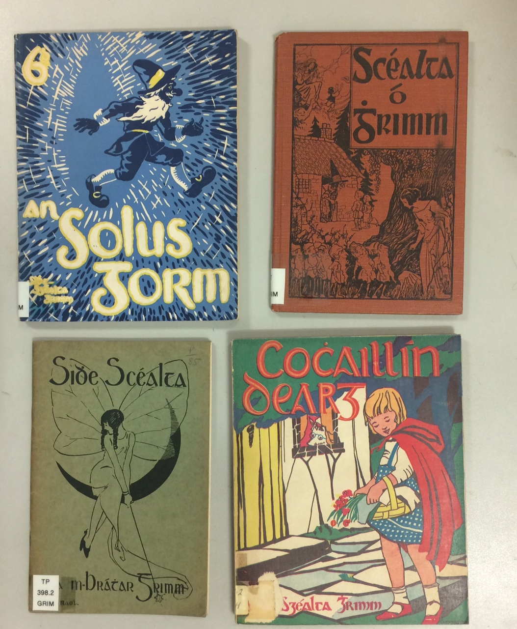 Covers to four Irish language versions of Grimm fairytales.
