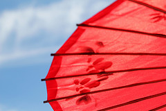 Red umbrella against blue sky