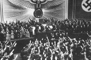 "German Chancellor Adolf Hitler receives the ovation of the Reichstag in Berlin in March 1938 after announcing the ""peaceful"" acquisition of Austria."