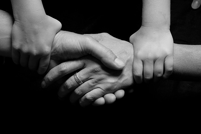 Image: hands holding each other