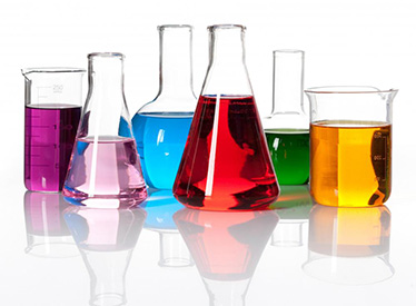 Many chemistry glassware filled with various colored liquid