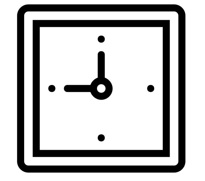 The face of a black windup alarm clock
